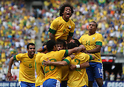 JUNE 09 2012:   Marcelo (6) of Brazil leaps on players celebrating the third Brazil goal by Hulk (20)l during an international friendly match against Argentina at Metlife Stadium in East Rutherford,New Jersey. Argentina won 4-3.