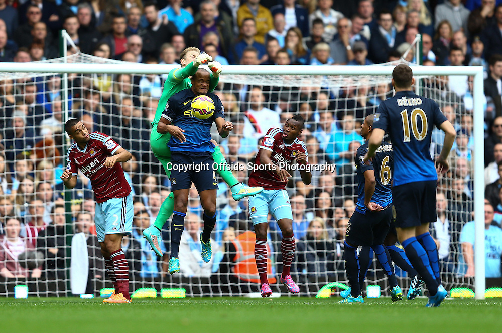 25 October 2014 - Barclays Premier League - West Ham v Manchester City - Joe Hart and Vincent Kompany of Manchester City go for the same ball - Photo: Marc Atkins / Offside.