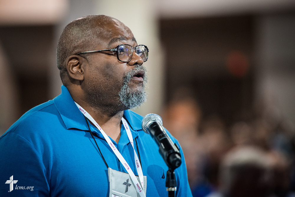 Ellory Glenn, a lay voting delegate for English District from Ferguson, Mo., speaks in favor of a resolution from Floor Committee 3 to commend the work of LCMS National Housing Support Corporation during the 66th Regular Convention of The Lutheran Church–Missouri Synod on Sunday, July 10, 2016, at the Wisconsin Center in Milwaukee. LCMS/Frank Kohn