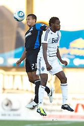 July 20, 2011; Santa Clara, CA, USA;  San Jose Earthquakes defender Nana Attakora (27) wins a head ball from Vancouver Whitecaps midfielder Terry Dunfield (7) during the first half at Buck Shaw Stadium. San Jose tied Vancouver 2-2.