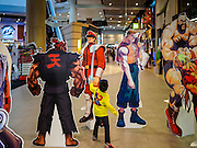26 FEBRUARY 2017 - BANGKOK, THAILAND: A Thai child sword fights, using a balloon, with anime characters in a Bangkok shopping mall.         PHOTO BY JACK KURTZ