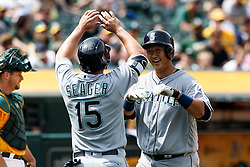 OAKLAND, CA - MAY 04: Dae-Ho Lee #10 of the Seattle Mariners is congratulated by Kyle Seager #15 after hitting a two run home run against the Oakland Athletics during the seventh inning at the Oakland Coliseum on May 4, 2016 in Oakland, California. (Photo by Jason O. Watson/Getty Images) *** Local Caption *** Dae-Ho Lee; Kyle Seager