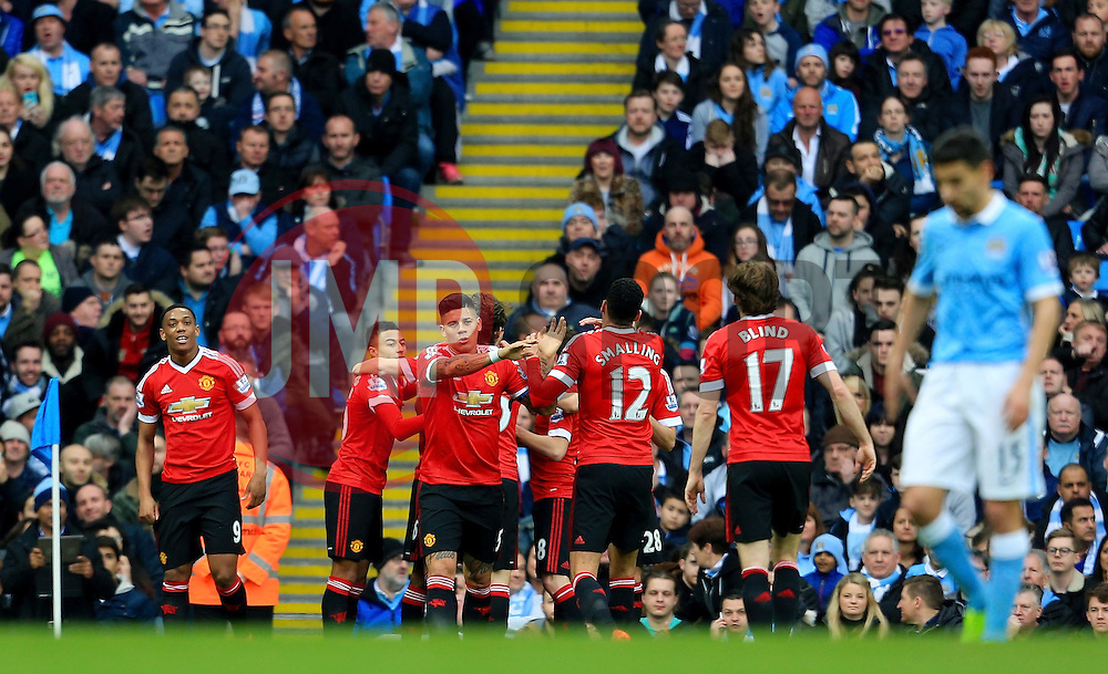 Marcus Rashford of Manchester United celebrates after scoring his sides first goal  - Mandatory byline: Matt McNulty/JMP - 20/03/2016 - FOOTBALL - Etihad Stadium - Manchester, England - Manchester City v Manchester United - Barclays Premier League