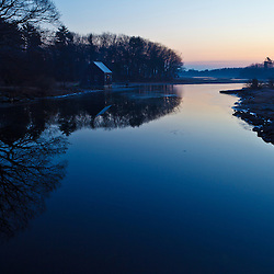 A boat house on a tidal creek in Rye, New Hampshire. Sunrise.