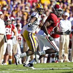 November 6, 2010; Baton Rouge, LA, USA; LSU Tigers cornerback Patrick Peterson (7) defends against Alabama Crimson Tide wide receiver Julio Jones (8) during the first half at Tiger Stadium.  Mandatory Credit: Derick E. Hingle