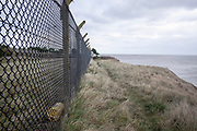 © Licensed to London News Pictures. 22/10/2017. Bawdsey, UK.  Fencing surrounding the base with a yellow container contains a radioactive symbol. . RAF Bawdsey, WW2 radar and Cold-War Bloodhound Surface to Air Missile (SAM) base at Bawdsey Ferry, Suffolk, today 22nd October 2017. The base was decommissioned in 1991 leaving behind a deserted base.  Photo credit: Stephen Simpson/LNP