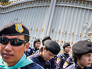 22 DECEMBER 2013 - BANGKOK, THAILAND: Thai riot police guard the home of caretaker Prime Minister Yingluck Shinawatra. Hundreds of thousands of Thais gathered in Bangkok Sunday in a series of protests against the caretaker government of Yingluck Shinawatra. The protests are a continuation of protests that started in early November and have caused the dissolution of the Pheu Thai led government of Yingluck Shinawatra. Protestors congregated at home of Yingluck and launched a series of motorcades that effectively gridlocked the city. Yingluck was not home when protestors picketed her home.     PHOTO BY JACK KURTZ