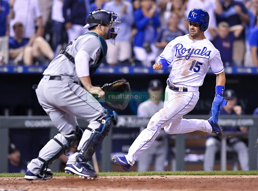 August 3, 2017 - Kansas City, MO, USA - The Kansas City Royals' Whit Merrifield (15) scores past Seattle Mariners catcher Mike Zunino on a hit by Melky Cabrera in the seventh inning at Kauffman Stadium in Kansas City, Mo., on Thursday, Aug. 3, 2017. (Credit Image: © John Sleezer/TNS via ZUMA Wire)