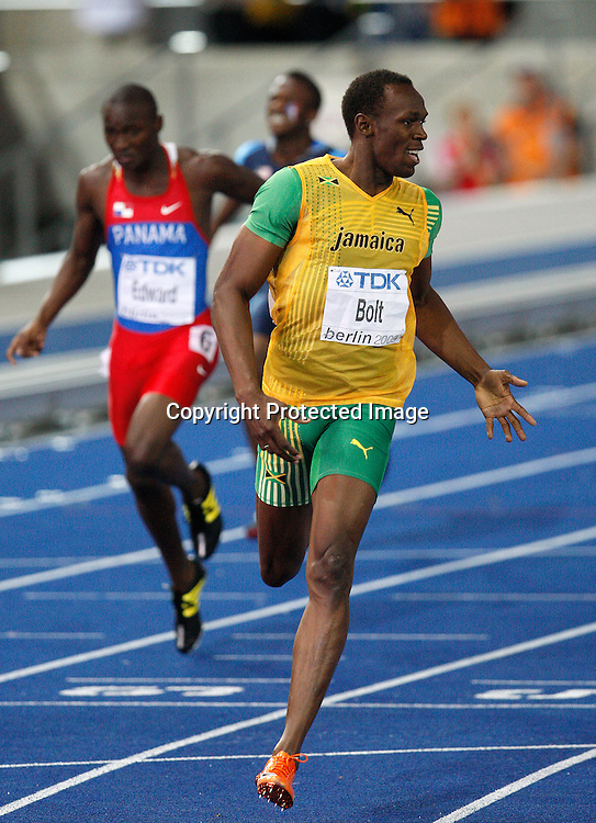 Usain Bolt of Jamaica celebrates after he won ahead of the competition in the men's 200 meters final. Bolt won the race with a new world record time of 19.19 seconds. 12th IAAF Athletic World Championships at the Olympic Stadium in Berlin, Germany, 20 August 2009. Photo: Wrofoto/PHOTOSPORT