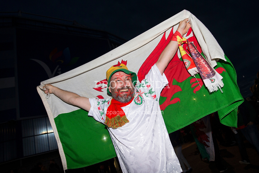 CARDIFF, WALES - Monday, October 9, 2017: A Wales' supporter with a flag outside the stadium before the 2018 FIFA World Cup Qualifying Group D match between Wales and Republic of Ireland at the Cardiff City Stadium. (Pic by Paul Greenwood/Propaganda)