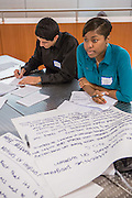 Purchase, NY – 31 October 2014. Giselle Cole, right, and team member Ibrahim Haddad, with notes for the Gorton High School team. The Business Skills Olympics was founded by the African American Men of Westchester, is sponsored and facilitated by Morgan Stanley, and is open to high school teams in Westchester County.