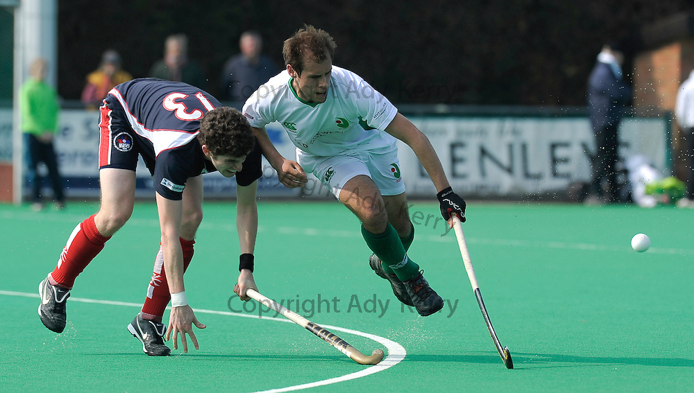 Canterbury's Tom Butt (R) challenges with Brookland's Peter Friend during their England Hockey League Premier Division match at  Polo Farm, Canterbury, Kent, 27th March 2011.
