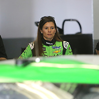 Danica Patrick, driver of the #7 GoDaddy Chevrolet stands alone in the garage area during practice for the 60th Annual NASCAR Daytona 500 auto race at Daytona International Speedway on Friday, February 16, 2018 in Daytona Beach, Florida.  (Alex Menendez via AP)