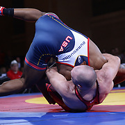 Jordan Burroughs, USA, (blue) in action against, Magomed Kurbanaliyev, Russia, (red) as wrestlers from USA, Iran and Russia compete at Grand Central Terminal as part of the Beat the Streets Gala. Billed ?The Rumble On The Rails,? the international wrestling event showcased competition as part of World Wrestling Month. Vanderbilt Hall, Grand Central Station, Manhattan,New York. USA. 15th May 2013. Photo Tim Clayton