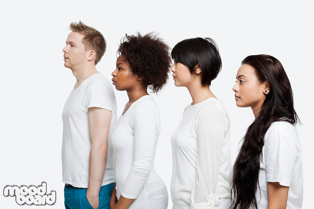 Side view of young multi-ethnic friends in casuals standing in line over white background