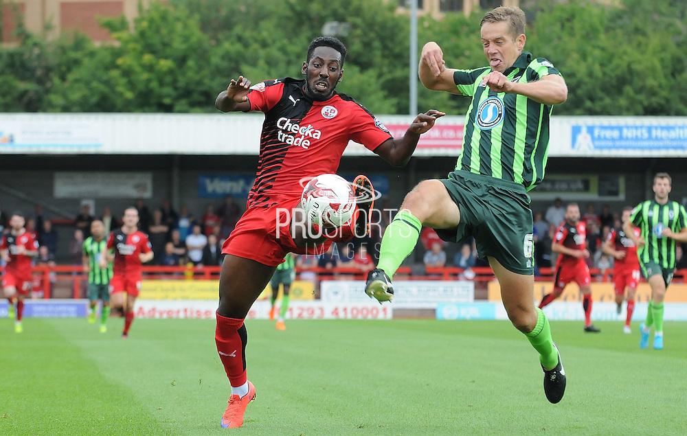 Roarie Deacon and Paul Robinson going for the loose ball during the Sky Bet League 2 match between Crawley Town and AFC Wimbledon at the Checkatrade.com Stadium, Crawley, England on 15 August 2015. Photo by Michael Hulf.