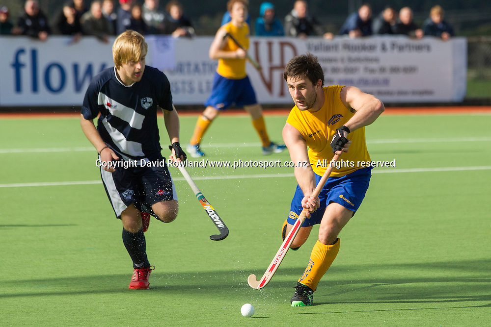 Auckland`s Ben Radonovich chases Southern`s Kane Russell in the Auckland v Southern Men`s semi-final match, Ford National Hockey League, North Harbour Hockey Stadium, Auckland, New Zealand,Saturday, September 13, 2014. Photo: David Rowland/Photosport