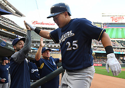 May 18, 2018 - Minneapolis, MN, U.S. - MINNEAPOLIS, MN - MAY 18: Milwaukee Brewers First base Ji-Man Choi (25) high-fives Milwaukee Brewers First base Ryan Braun (8) after hitting a solo home run in the top of the 2nd during a MLB game between the Minnesota Twins and Milwaukee Brewers on May 18, 2018 at Target Field in Minneapolis, MN. The Brewers defeated the Twins 8-3.(Photo by Nick Wosika/Icon Sportswire) (Credit Image: © Nick Wosika/Icon SMI via ZUMA Press)