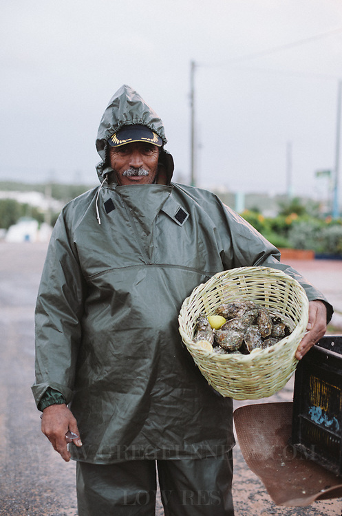 A local fisherman and hic catch of oysters. Oualidia, Morocco.