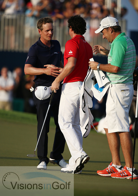 Rory McIlroy and Luke Donald during the final round<br /> at the DP World Tour Championship, Jumeirah Golf Estates Earth, Dubai UAE 2012<br /> Picture Credit:  Mark Newcombe / www.visionsingolf.com