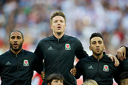 LYON, FRANCE - Wednesday, July 6, 2016: Wales captain Ashley Williams, goalkeeper Wayne Hennessey and Neil Taylor sing the national anthem before the UEFA Euro 2016 Championship Semi-Final match against Portugal at the Stade de Lyon. (Pic by David Rawcliffe/Propaganda)