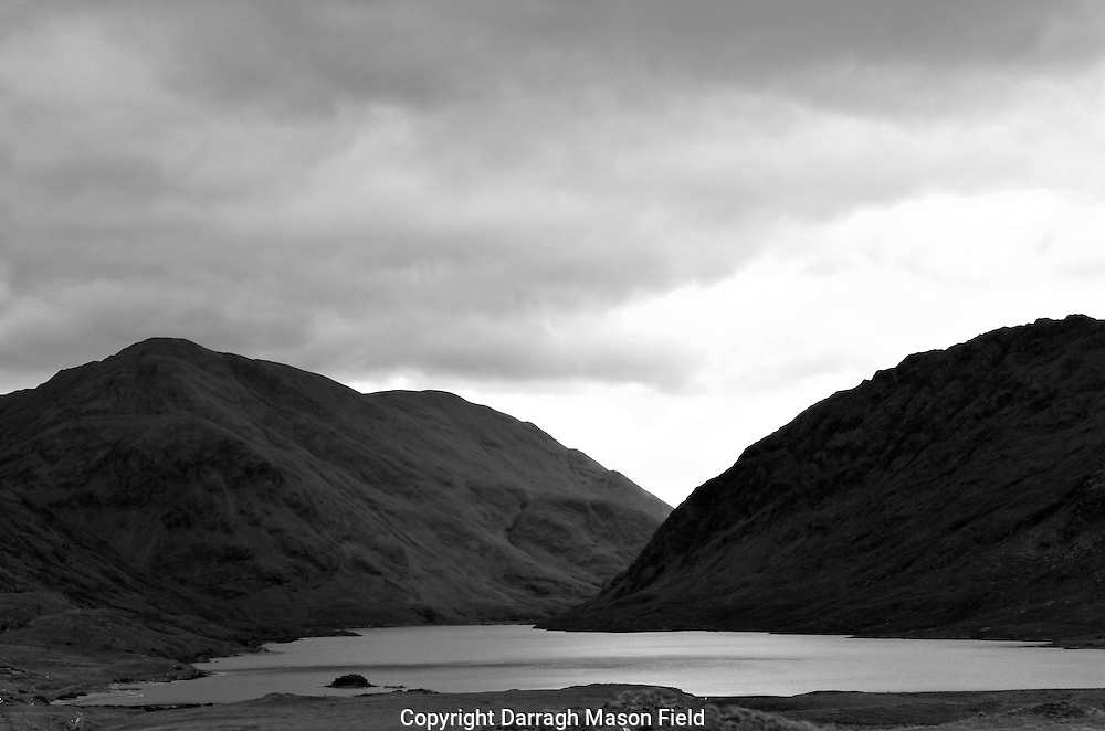 Doolough valley near Louisberg, site of the Famine walk. The famine walk retraces 'a journey of horror' which local people made through the Doolough Valley on the night and morning of 30-31 March 1849. The immediate cause of the death march was the arrival of two 'commissioners', who were to inspect the people and certify them as paupers, so entitling them to a ration of three pounds of meal each. For some reason the inspection was not made and the hundreds of people were told they must appear at Delphi Lodge (ten miles away) at 7am the following morning. They set out on foot along the mountain road and pathway in cold, wintry conditions, including snowfall. When they arrived at Delphi Lodge, they were refused either food or tickets of admission to the workhouse and so they began their weary return journey. It was on this journey that maybe hundreds of people died.