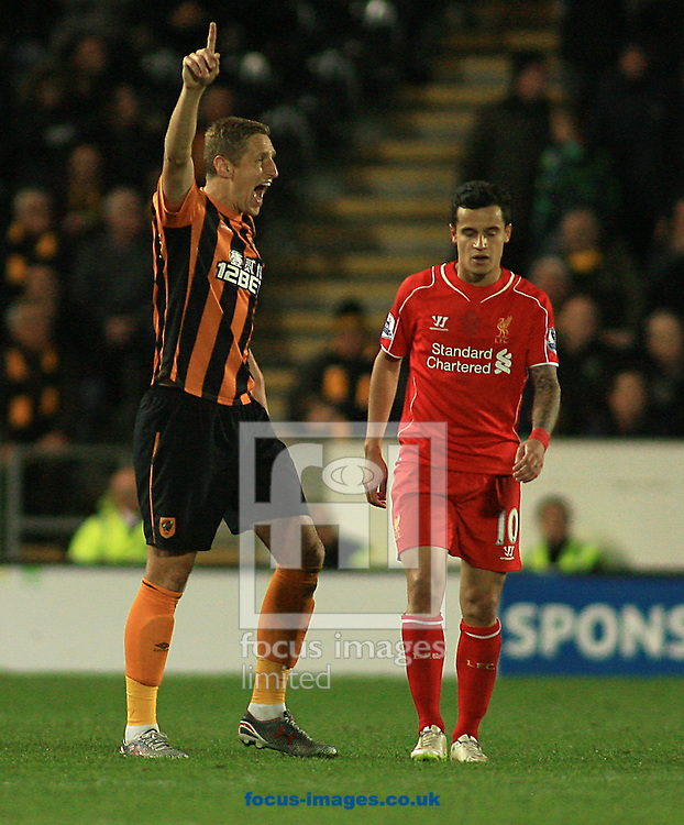 Michael Dawson (left) of Hull City and Philippe Coutinho of Liverpool during the Barclays Premier League match at KC Stadium, Hull<br /> Picture by Richard Gould/Focus Images Ltd +44 7855 403186<br /> 28/04/2015