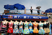 A shop selling swimming dresses at the N.6 Beach in Qingdao. Qingdao is a a very popular place among Chinese tourist and many will visit the coastal city in the summer months..