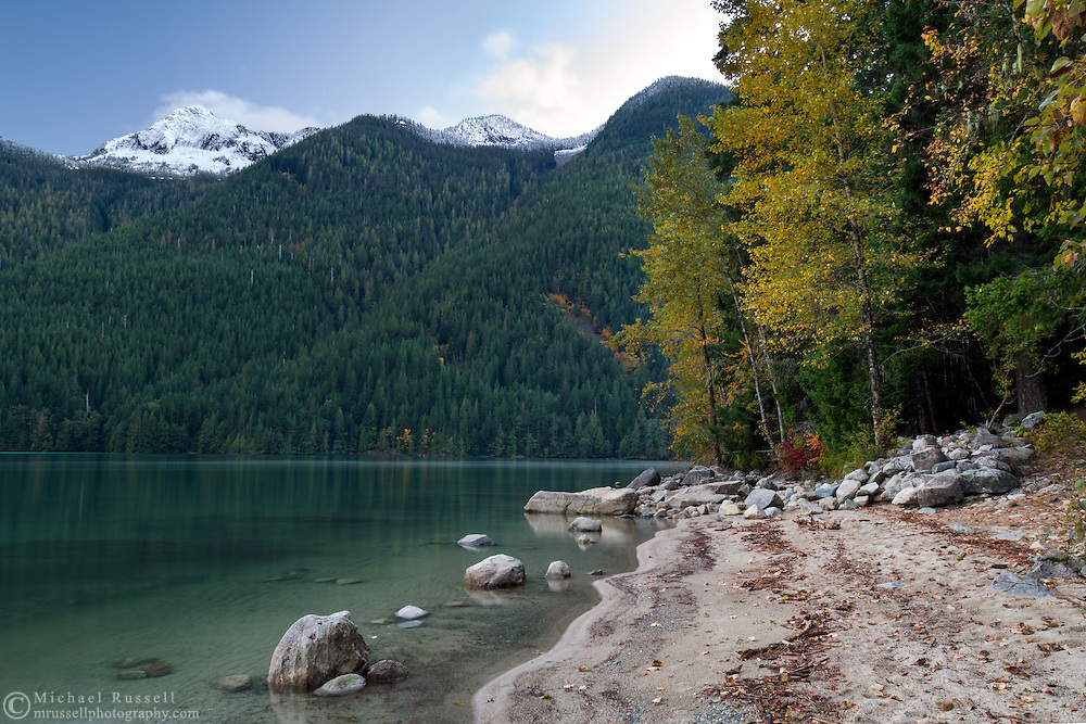 Fresh snow on Mount Webb and fall foliage colours at Chilliwack Lake in Chilliwack Lake Provincial Park, Chilliwack, British Columbia, Canada