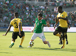 July 23, 2017 - Pasadena, California, U.S - Rodolfo Pizarro #15 of Mexico, Damion Lowe #3 and Je-Vaughn Watson #15 of Jamaica battle for the ball during their Gold Cup Semifinal game at the Rose Bowl in Pasadena, California on Sunday July 23, 2017. Jamaica defeats Mexico, 1-0. (Credit Image: © Prensa Internacional via ZUMA Wire)