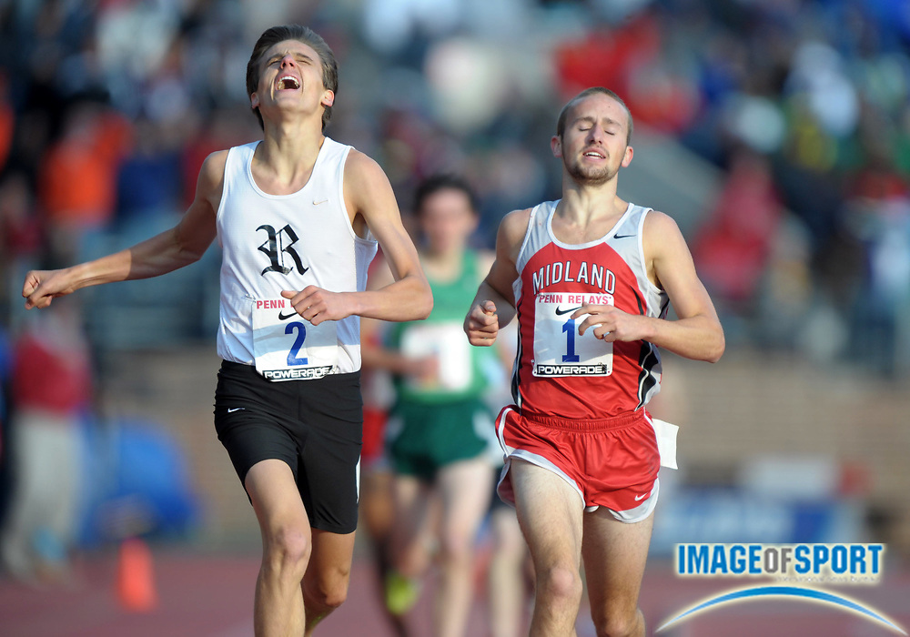 Apr 27, 2012; Philadelphia, PA, USA; Craig Engels of Ronald Reagan (NC) defeats Jacob Burdham of Cabell Midland (WV) to win the championship mile  4:09.42 to 4:09.49 in the 118th Penn Relays at Franklin Field.