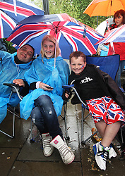 Spectators along the Embankment for the Thames Diamond Jubilee Pageant in London, Sunday 3rd  June 2012.  Photo by: Stephen Lock / i-Images