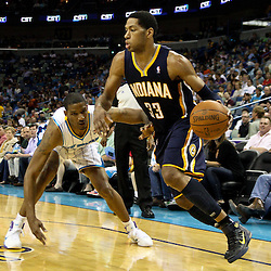 April 3, 2011; New Orleans, LA, USA; Indiana Pacers small forward Danny Granger (33) drives past New Orleans Hornets small forward Trevor Ariza (1) during the fourth quarter at the New Orleans Arena. The Hornets defeated the Pacers 108-96.  Mandatory Credit: Derick E. Hingle