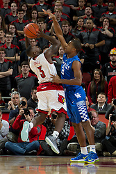 Kentucky guard Aaron Harrison, right, contests a shot by Louisville guard Chris Jones in the first half. <br /> <br /> The University of Louisville hosted the University of Kentucky, Saturday, Dec. 27, 2014 at The Yum Center in Louisville.