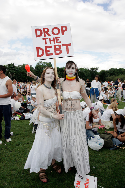 MAKE POVERTY HISTORY Two young protesters contribute to the campaign effort all in White! .Date picture taken 2nd July Edingburgh make poverty history Rally. photo published in The Newstatesman 11july 2005 The biggest ever anti-poverty movement came together under the banner of MAKEPOVERTYHISTORY in 2005 calling for urgent action for more and better aid, debt cancellation and trade justice.<br />