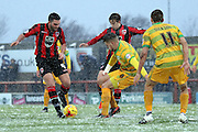 Morecambe Midfielder Alex Kenyon challengesduring the Sky Bet League 2 match between Morecambe and Yeovil Town at the Globe Arena, Morecambe, England on 16 January 2016. Photo by Pete Burns.