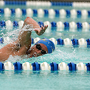 Jorge Excarcega of the El Paso Aqua Posse comes up for air as he swims the second leg of the boys 15 and over freestyle relay event Thursday evening during the West Texas Invitational at Doug Russell Pool in Midland, TX.