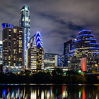 Austin TX skyline at night along the colorado river in the Southwestern United States of America. Photo was taken in 2016.