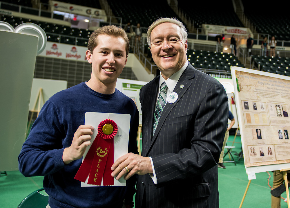 Seth Comes poses for a picture with Ohio University President Duane Nellis during the 2018 Student Research Expo.