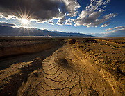 A dry wash traverses the valley floor in Death Valley National Park.