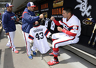 CHICAGO - APRIL 22:  Hector Santiago #53 of the Chicago White Sox greets teammates while carrying the jersey of critically ill teammate Danny Farquhar #43 to the bullpen, where it will hang in tribute to their teammate during the game against the Houston Astros on April 22, 2018 at Guaranteed Rate Field in Chicago, Illinois.  (Photo by Ron Vesely)   Subject:   Hector Santiago; Danny Farquhar
