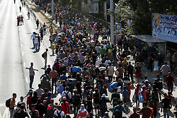 © Licensed to London News Pictures. 04/09/2015. Budapest, Hungary. Migrants start the long walk from Budapest Keleti station in Hungary to the Austrian border after failing to get on trains. Photo credit: Gabriel Szabo/LNP