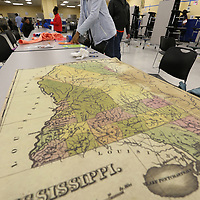Destini Davis, 13, starts to prep the posters that her classmates are going to hang around a timeline outlining the state's history for the last 200 years as part of Mississippi's Bicentennial celebration.