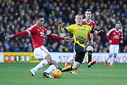 Chris Smalling of Manchester United beats Ben Watson of Watford to the ball during the Barclays Premier League match between Watford and Manchester United at Vicarage Road, Watford, England on 21 November 2015. Photo by Phil Duncan.