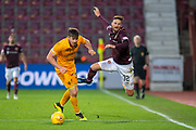 Declan Gallagher (#31) of Livingston FC sends new signing David Vanecek (#32) of Heart of Midlothian FC flying through the air during the 4th round of the William Hill Scottish Cup match between Heart of Midlothian and Livingston at Tynecastle Stadium, Edinburgh, Scotland on 20 January 2019.