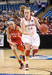 March 27, 2010; Sacramento, CA, USA; Stanford Cardinal forward Kayla Pedersen (14) dribbles past Georgia Bulldogs guard Meredith Mitchell (11) during the first half in the semifinals of the Sacramental regional in the 2010 NCAA womens basketball tournament at ARCO Arena. Stanford defeated Georgia 73-36.