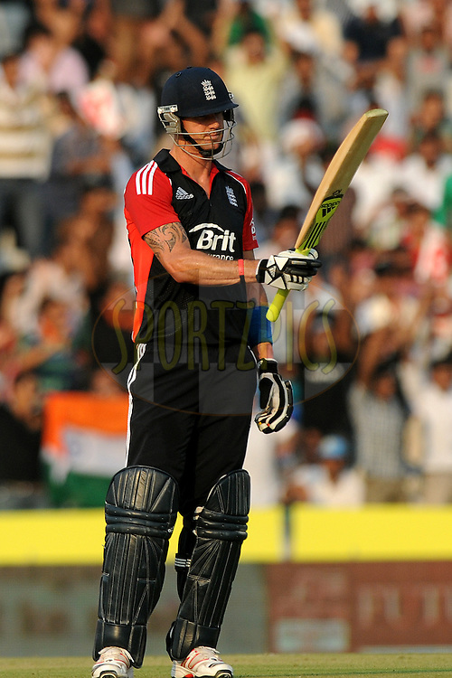 Kevin Pietersen of England celebrates after hitting a half century during the 3rd One Day International ( ODI ) match between India and England held at  the PCA Stadium, Mohali on the 20th October 2011..Photo by Pal Pillai/BCCI/SPORTZPICS
