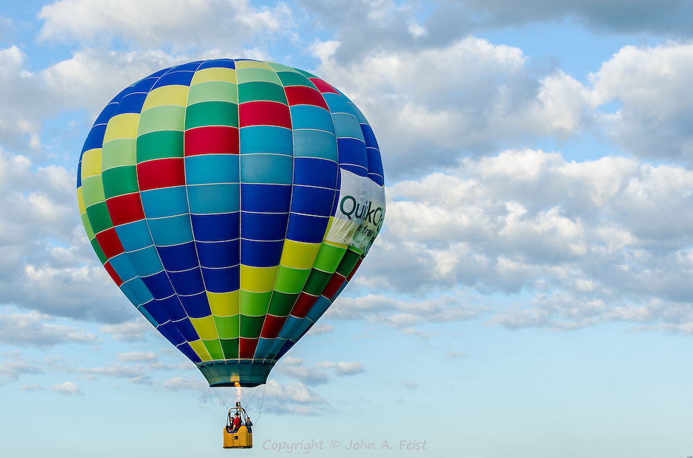 Apparently QuickCheck is a big corporate sponsor of hot air ballooning.  This balloon has their name across it.  I was fortunate to capture this shot while the pilot was firing the burner to go a bit higher.