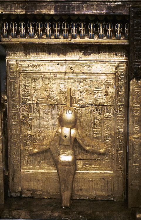 Tutankhamun (Tutenkamen) d.c.1340 BC 18th dynasty Egyptian Pharaoh. Guardian figure on his golden sarcophagus.