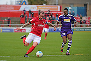 Ebbsfleet United forward Danny Kedwell (9) makes a cross during the Vanarama National League South match between Ebbsfleet United and East Thurrock United at the Enclosed Ground, Whitehawk, United Kingdom on 4 March 2017. Photo by Jon Bromley.